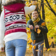Couple playing with autumn leaves — Stock Photo #57288817