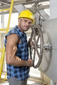 Worker fixing industrial valve — Stockfoto