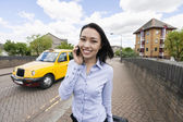 Businesswoman answering cell phone — Foto Stock