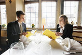 Business couple with menus — Stock Photo