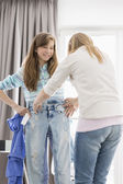 Sisters trying on clothes — Stock Photo