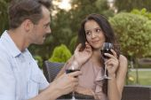 Couple holding wine glasses in park — Stock Photo