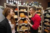 Salesperson showing cheese — Stock Photo