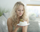 Woman looking at tempting cake — Stock Photo