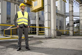 Engineer standing outside industry — Stockfoto