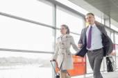Businessman and businesswoman rushing — Stock Photo