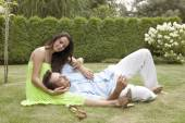 Young man lying on woman's lap — Stock Photo