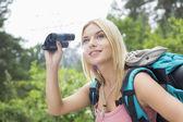Female hiker using binoculars — Stock Photo
