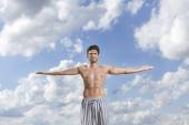 Man standing with arms wide open — Stock Photo