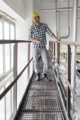 Worker standing on metal aisle — Stock Photo