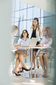 Businesswomen discussing at table — Stock Photo