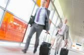 Businessmen with luggage rushing — Stock Photo