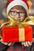 Girl holding wrapped Christmas present — Stock Photo