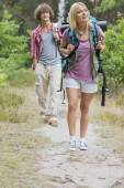 Hiking couple in forest — Stock Photo