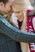 Couple in sweaters smiling — Zdjęcie stockowe