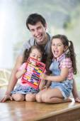 Father and daughters playing — Stock Photo