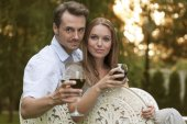 Young couple having red wine — Stock Photo