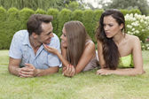 Woman looking at loving couple — Stock Photo