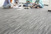 Businesspeople working on floor — Stock Photo
