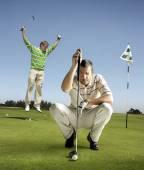 Golfers on putting green — Stock Photo