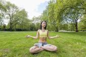 Woman doing  yoga — Stock Photo