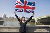 Woman holding British flag — Stock Photo
