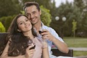 Young couple having red wine together — Stock Photo