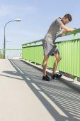 Man leaning on railing — Stock Photo