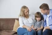 Parents sitting with upset son — Stok fotoğraf