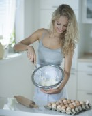 Woman mixing cookie batter — Stock Photo