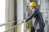 Architect leaning on railing — Stock Photo