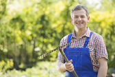 Gardener holding rake — Stock Photo
