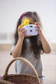 Little girl photographing — Stock Photo