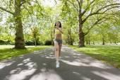 Woman jogging at park — Stock Photo