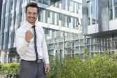 Businessman with clenched fist standing — Stock Photo
