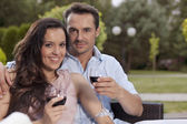 Couple having red wine in park — Foto Stock