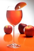 Drink in glass and apples — Stock Photo