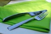 Fork and knife on cloth — Stock Photo