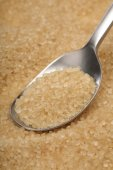 Brown sugar and spoon — Stockfoto