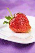 Strawberry on white plate — Stock Photo