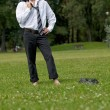Businessman standing in park — Stock Photo #72096761