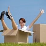 Woman sitting in cardboard box — Stock Photo #72096923