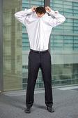 Businessman removing shirt — Stock Photo