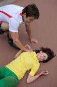 Skater injured  clutching arm — Stock Photo