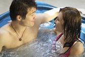 Couple bathing at jacuzzi — Stock Photo