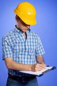 Architect  writing on clipboard — Stock Photo