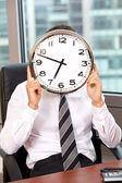 Businessman holding clock — Stock Photo