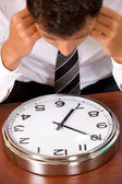 Businessman looking at clock — Stock Photo