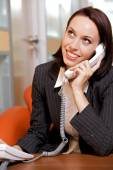 Businesswoman conversing on  phone — Stock Photo