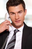 Businessman conversing on  phone — Stock Photo